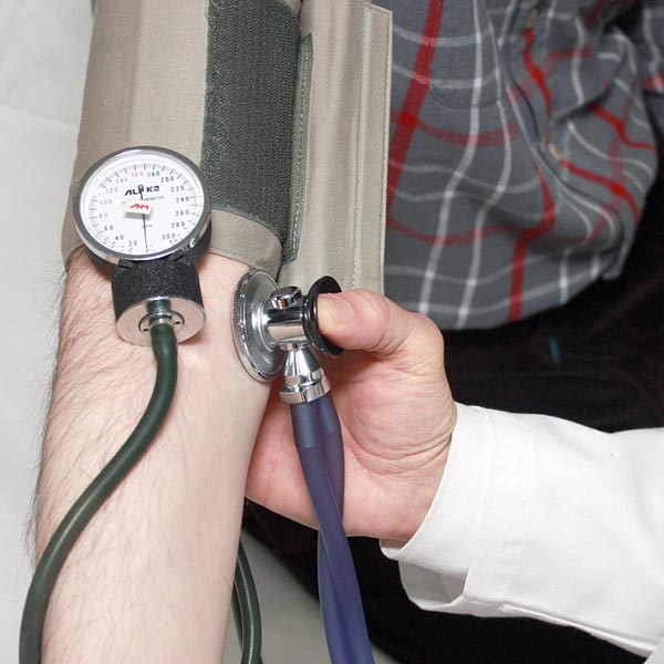 A patient undergoing pressure check, showing GP consultation available at Territory Medical Group