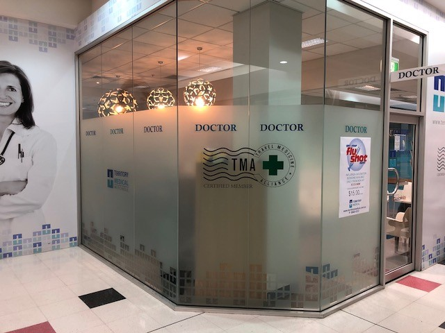 Front Entrance to Territory Medical Group showing flu shots and travel medicine service posters, Medical Centre Darwin