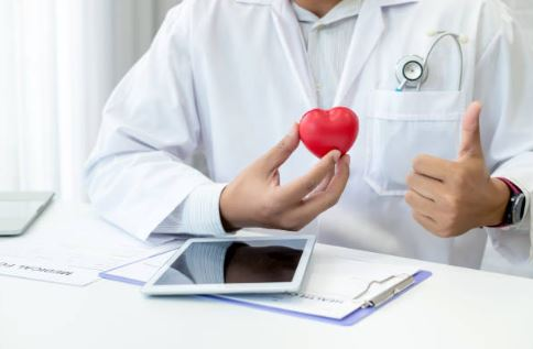 A doctor with a red heart showing chronic health disease is manageable, Territory Medical Group