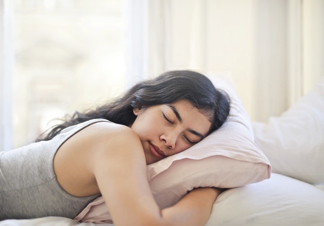 A woman sleeping well to promote her immune system as suggested by allergy doctor in Darwin